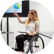 Woman in wheelchair pointing at presentation