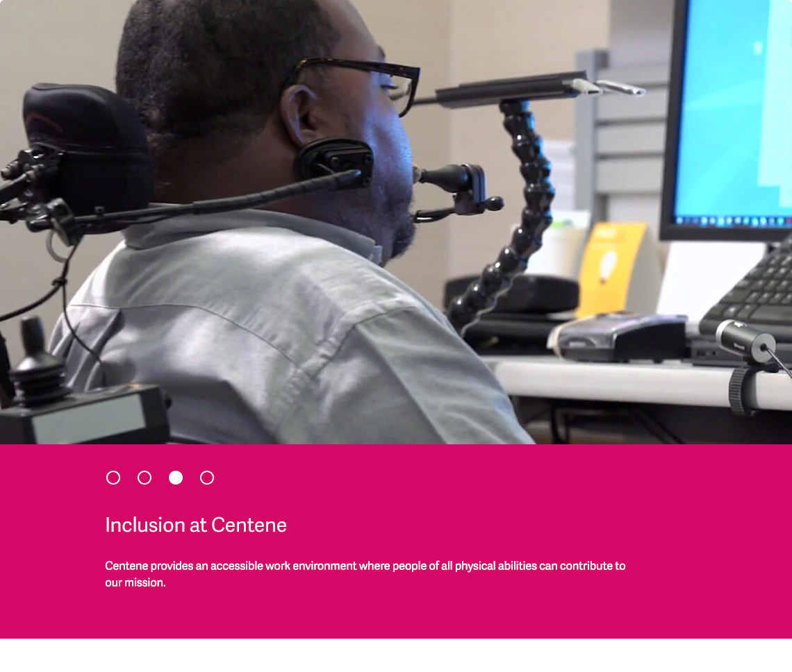Centene employee in a wheelchair using assisted technology to work