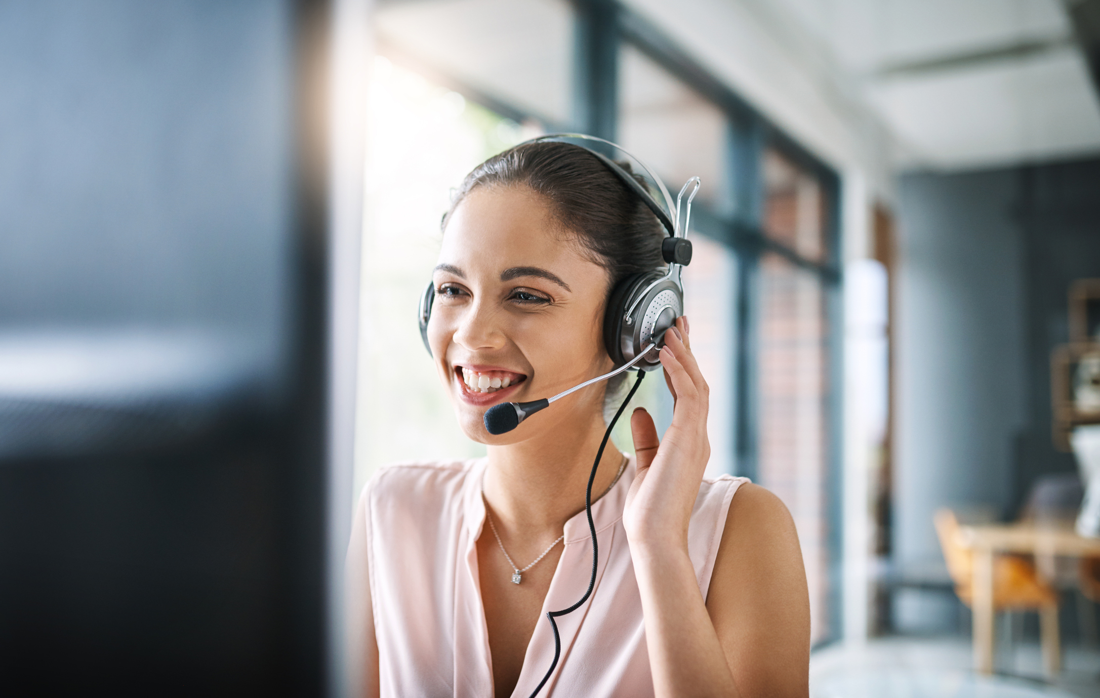 Female customer care representative with headset