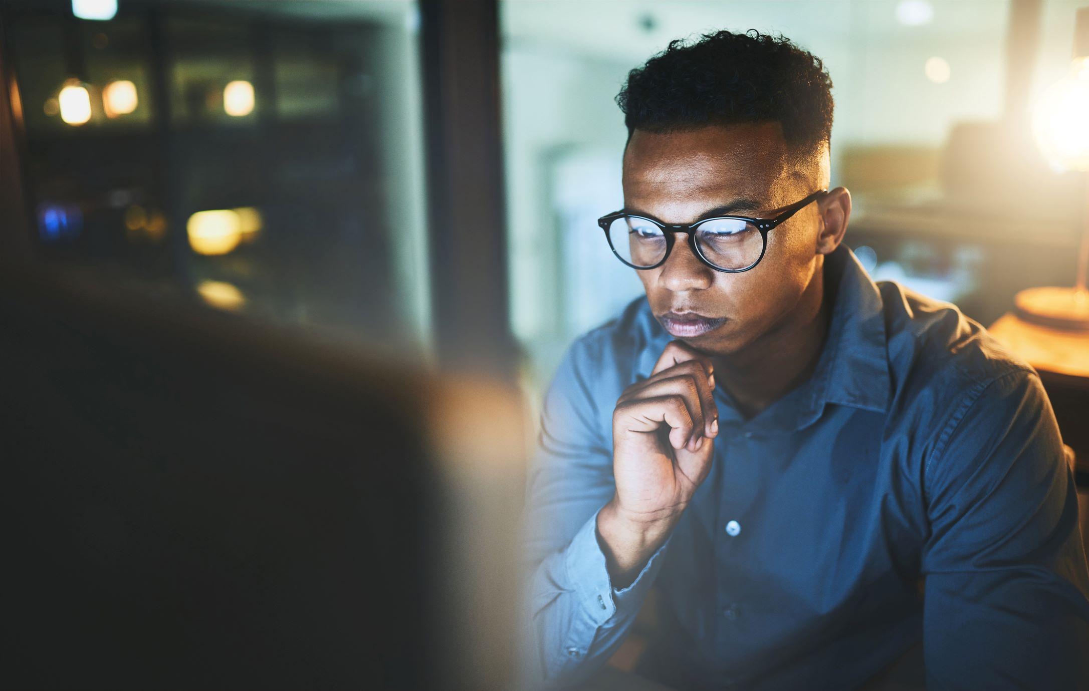 man looking at a monitor