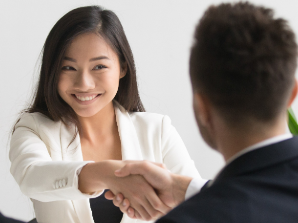 professional woman shaking hands with man