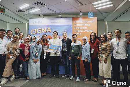 Cigna employees posing together for a large group photo at our Indonesia office.