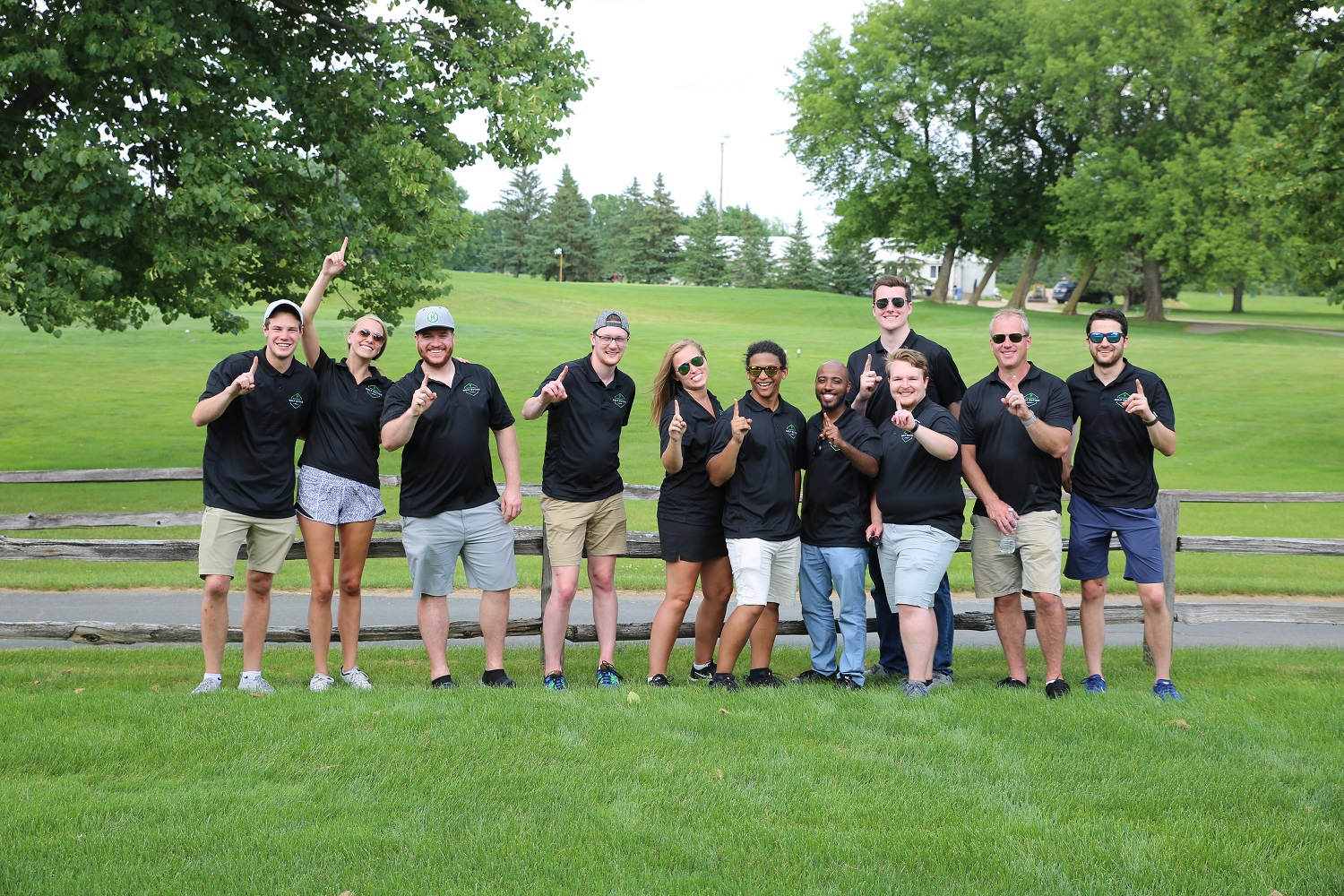 TECDP associates posing for a photo during a team event.