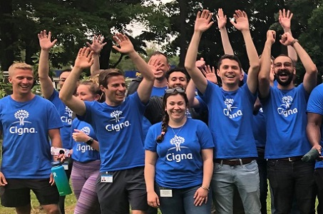 Summer interns posing excitedly at a volunteer event.