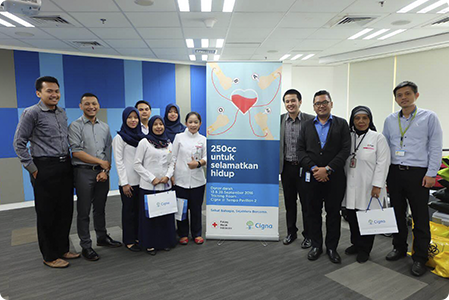 Cigna Indonesia employees posing together for a team photo.