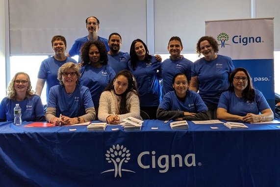Cigna Hispanic/Latino employee resource group members volunteering at a community event.