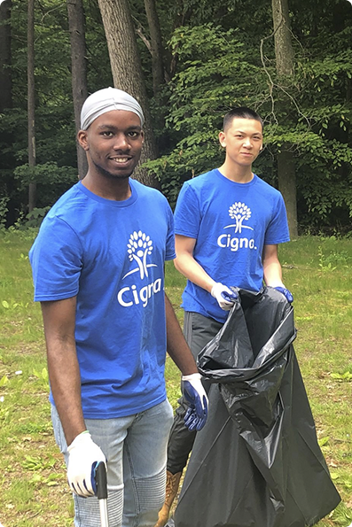 Cigna employees volunteering together out in the community.