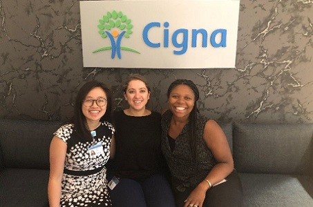 Managed Care Rotation Program associates posing in front of the Cigna logo