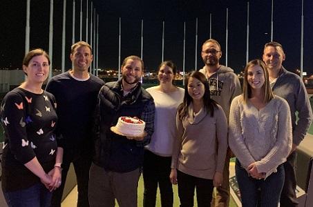 FDP associates posing at a Topgolf outing
