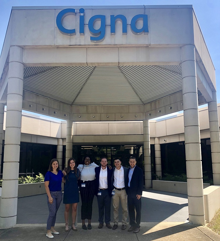 OLDP associates posing for a group photo in front of a Cigna office building.