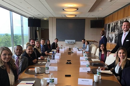 Cigna Sales Academy students posing in the board room.