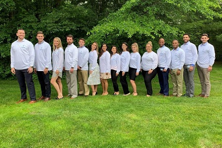 Cigna Sales Academy students posing with their white shirts.