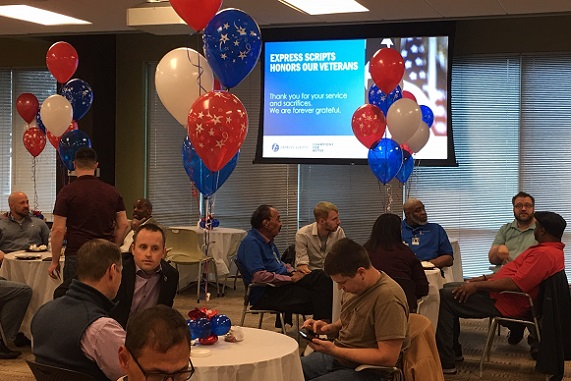 Flag raising ceremony taking place at our St. Louis office in celebration of Veterans Day.