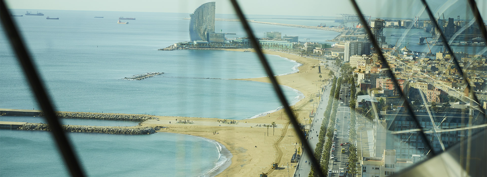 BCN beach through windows 1920x700