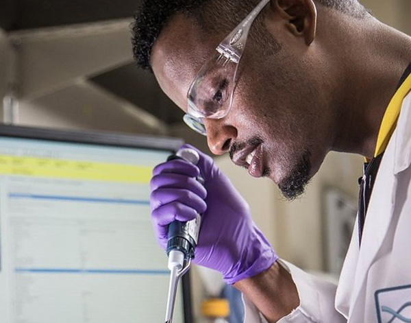 Photograph of IDT associate in lab