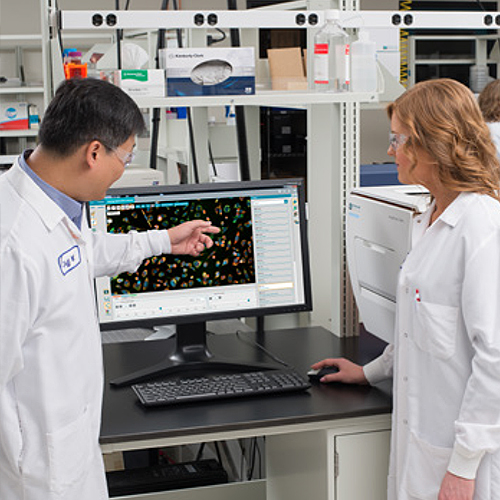 Photograph of Molecular Devices associates in a lab