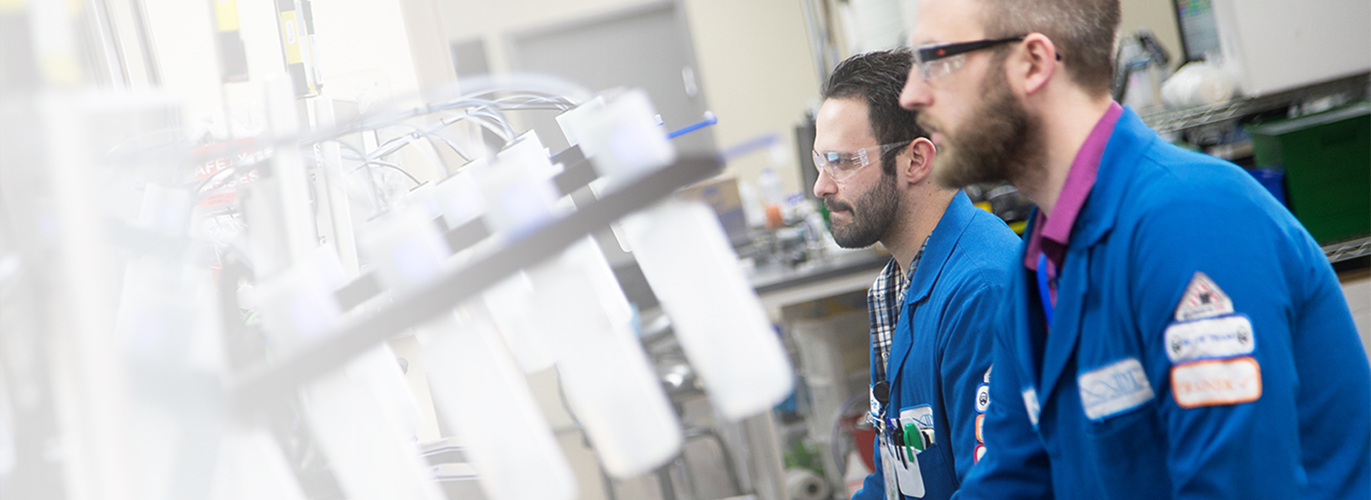 Photograph of Integrated DNA Technologies associates in lab