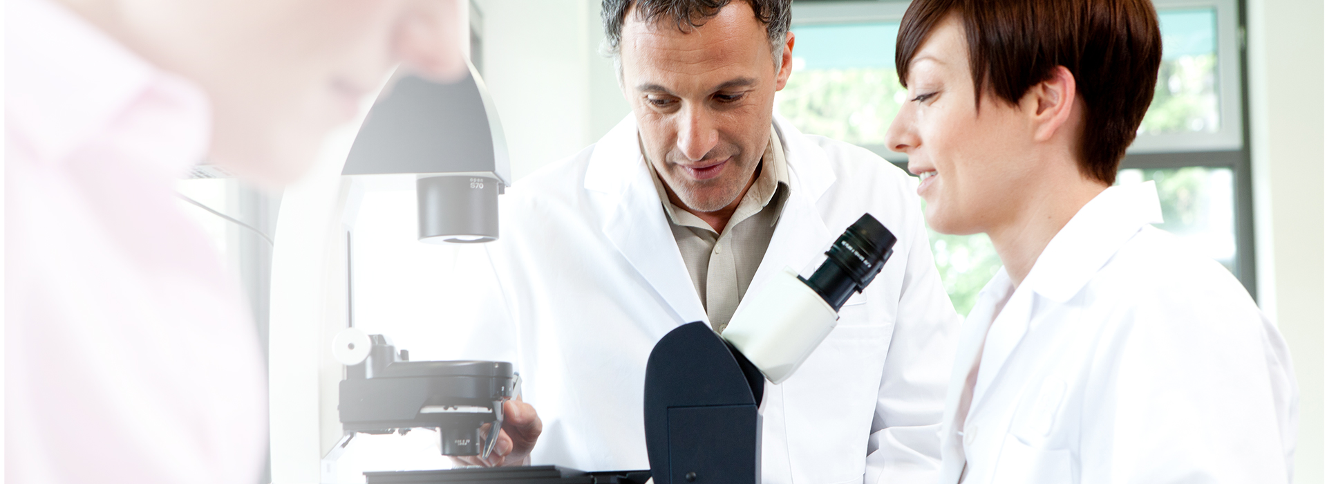 Photograph of Leica Microsystems associates in lab
