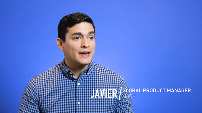 Photograph of Javier in front of blue background