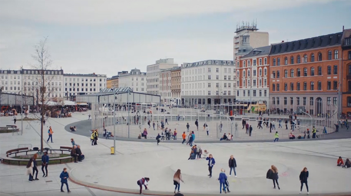 People walking in city square