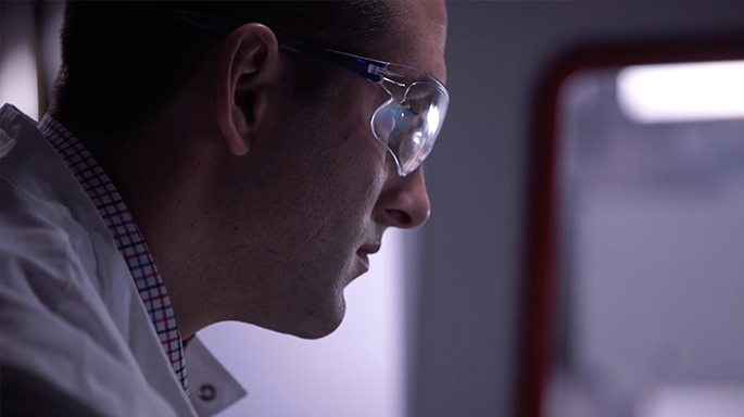 Photograph of Beckman Coulter LS associate in lab