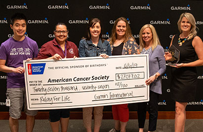 A team of Garmin associates presents a big check to the Relay for Life charity