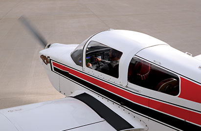 The nose and partial wing of a small plane