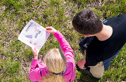 A girl and a boy at Garmin campus on an orienteering challenge