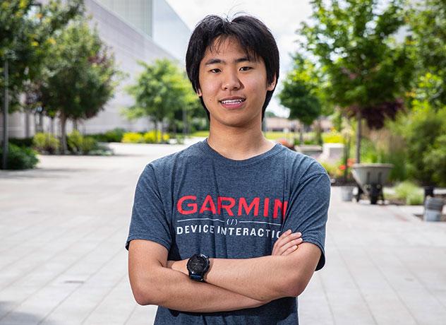 High school intern Josh stands near the entrance at Garmin headquarters