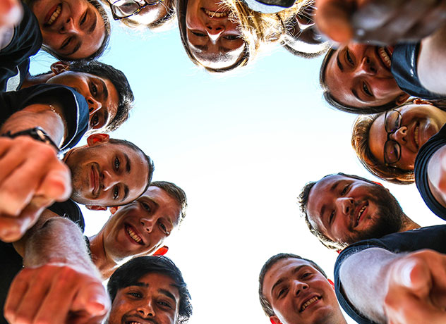 Smiling Garmin associates in a circle shot from below