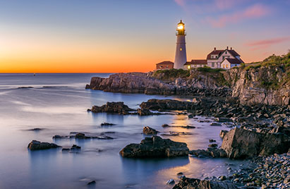 Lighthouse and rocky beach near Yarmouth, Maine