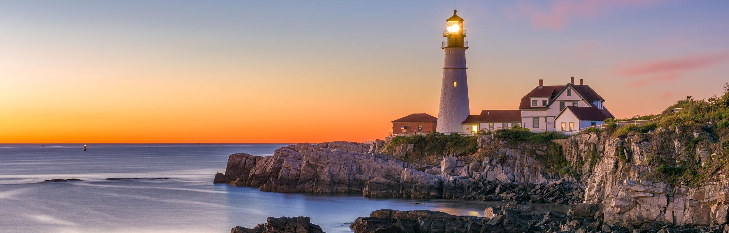 Lighthouse and rocky beach near Yarmouth, Maine