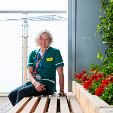 person with hospital uniform sitting on bench
