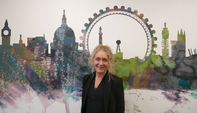 person in front of image of London