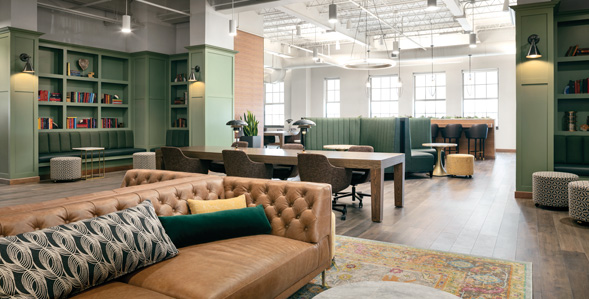 Couches, tables and chair in collaborative workspace setting.