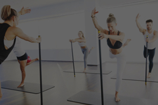 Members doing an exercise for barre fitness class