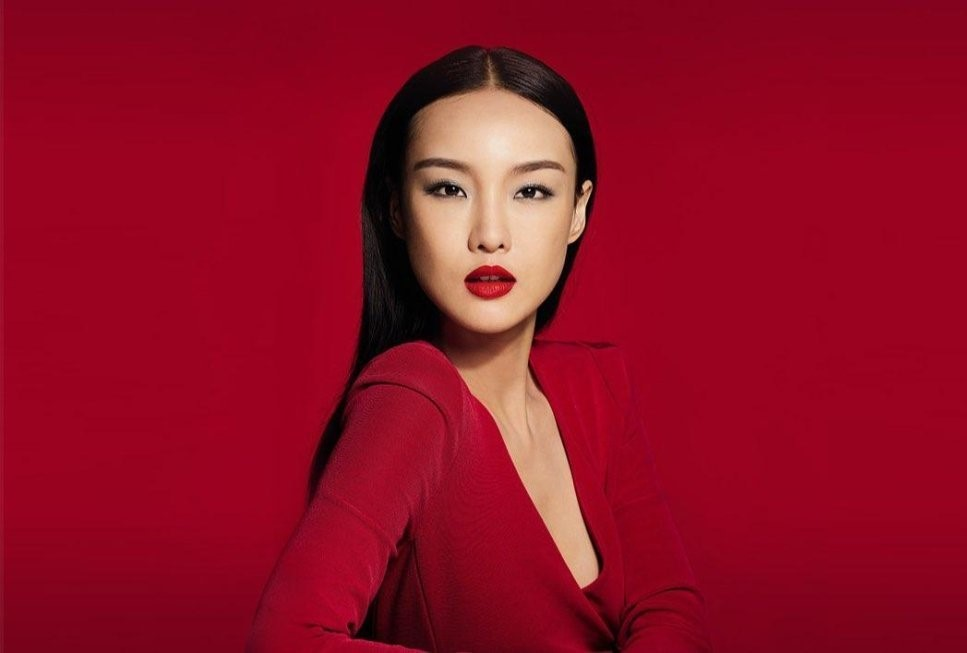 Asian model wearing red dress representing finance annual report 2018