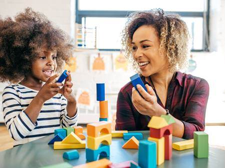 Mother and child playing with building blocks