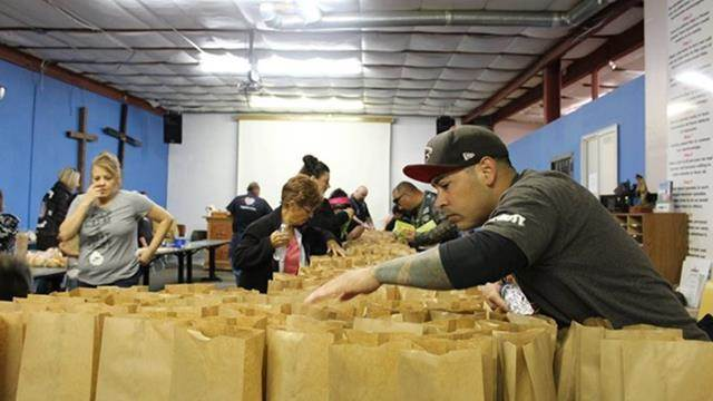 Employees doing volunteer work, making lunches