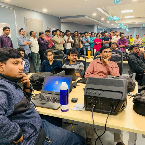 Employees gather in the India office for award recognition