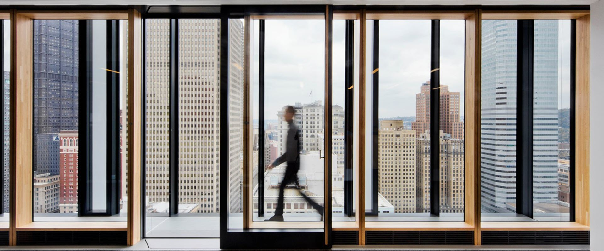Man walking through office corridor