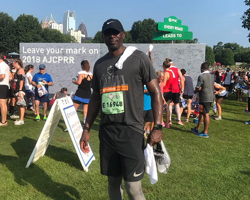 PNC employee, Willie, after completing a marathon