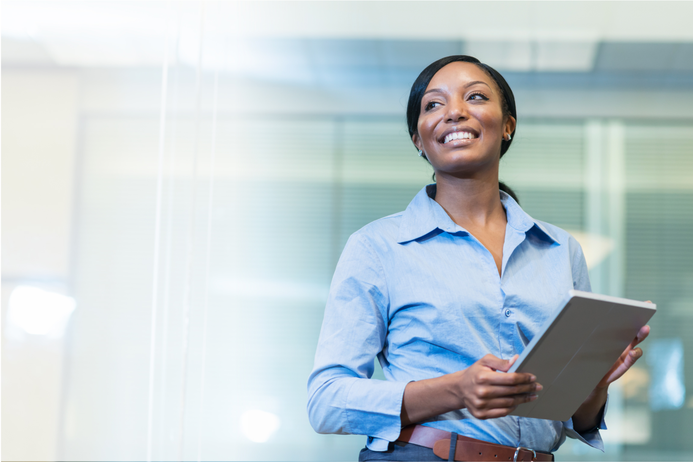 Woman standing in office smiling