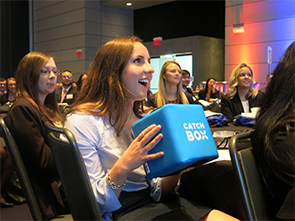 Collegiate woman asks question at event