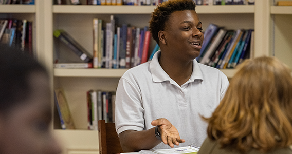 High school student participating in classroom conversation
