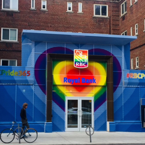 Branch entrance with a heart painted with the LGBT colours and the RBC logo with the LGBT colours.