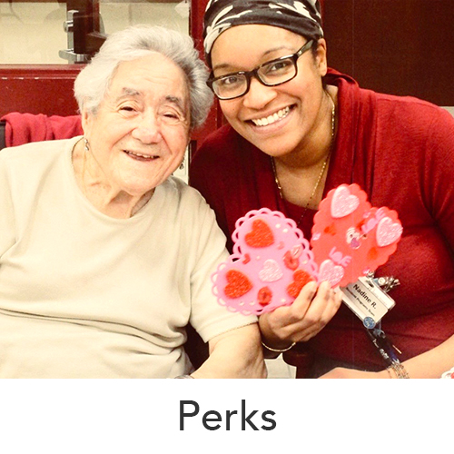 Perks image of a team member and a female senior smile in front of the camera
