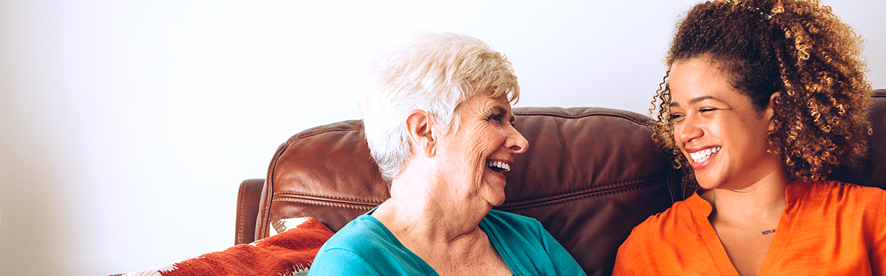 picture of a happy female senior laughing together with a team member