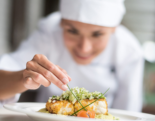 image of a female chef preparing for a lovely dish