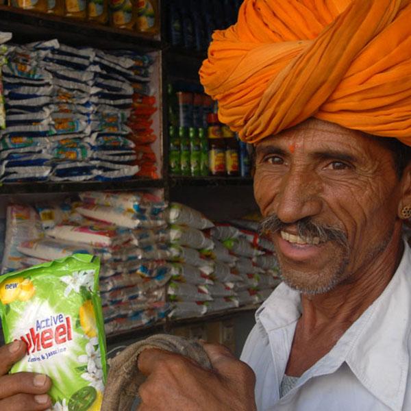 man smiling with detergant